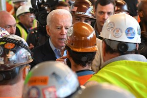 Biden chats with union workers during a campaign stop in 2020.