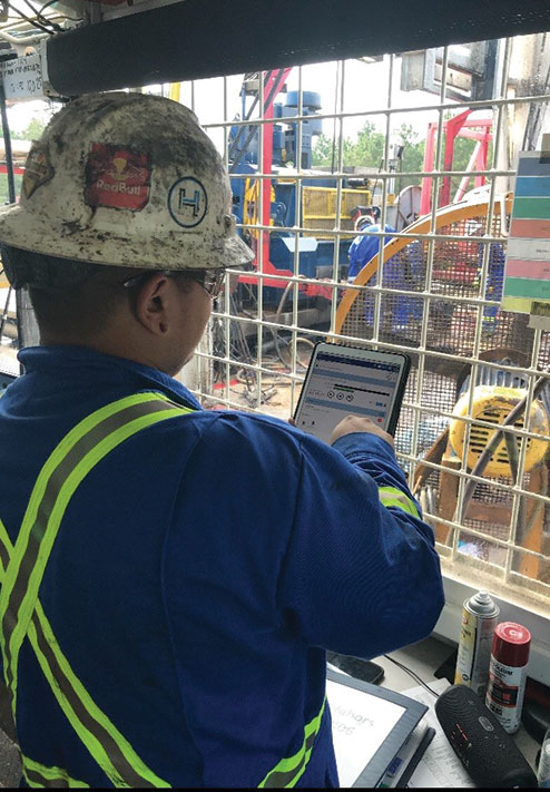 Fig. 1. A crew member using an iPad to run a Nabors' app.