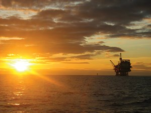 Sun setting on an offshore platform in the UK portion of the North Sea.